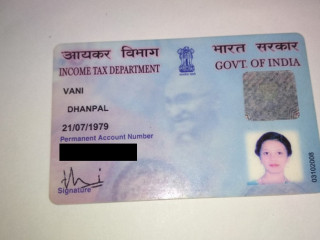 PAN card found at 8th main near 8th cross Auditorium.